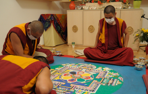 Cultivation of the Tibetan Buddhist tradition - spreading a Sand-Mandala